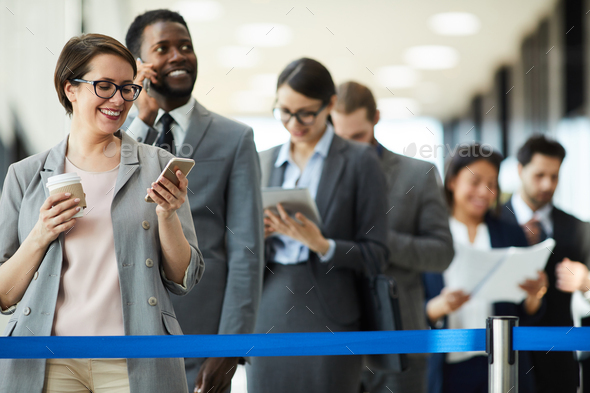 Ambitious business people waiting for forum - Stock Photo - Images