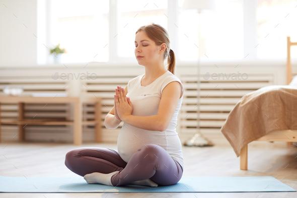 Pregnant Woman Meditating - Stock Photo - Images