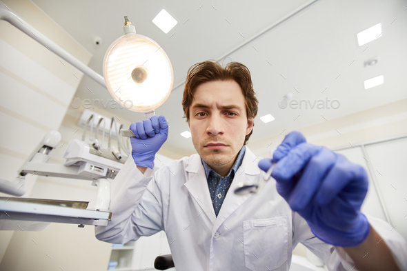 Dentist during Checkup - Stock Photo - Images
