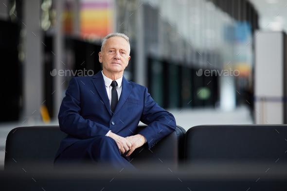 Senior Businessman in Lobby - Stock Photo - Images