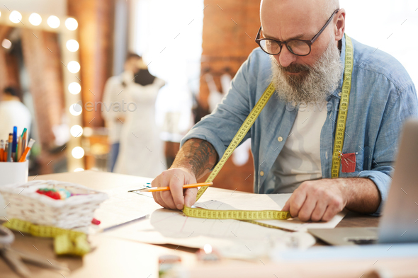 Tailor with measuring tape - Stock Photo - Images