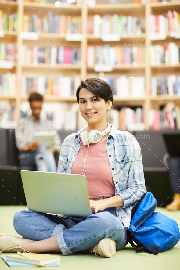 Student girl using online resource on laptop - Stock Photo - Images