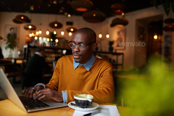 Blogger in Coffee Shop - Stock Photo - Images