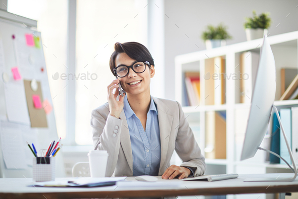 Woman working in office - Stock Photo - Images