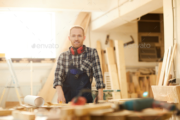 Young carpenter Posing in Workshop - Stock Photo - Images