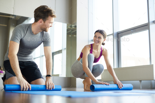 Jolly young people after yoga class - Stock Photo - Images