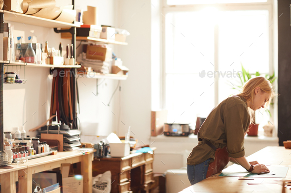 Young Woman in Workshop - Stock Photo - Images