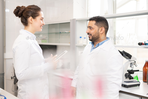 Multi-ethnic laboratory workers planning research - Stock Photo - Images
