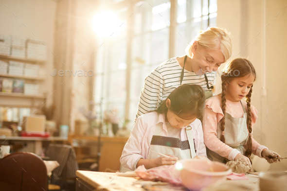 Two Little Girls in Pottery Class - Stock Photo - Images