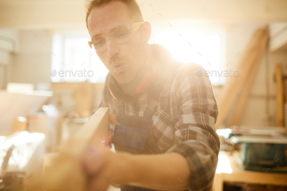 Carpenter Blowing Sawdust - Stock Photo - Images