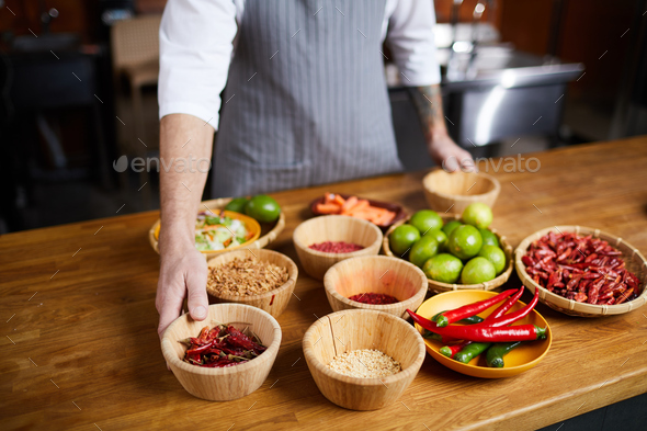 Professional Chef Choosing Spices - Stock Photo - Images
