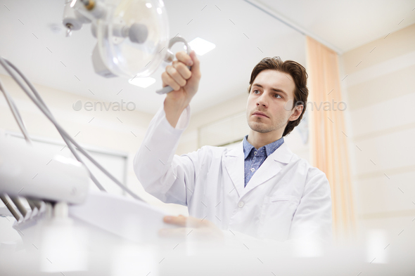 Dentist in Office - Stock Photo - Images