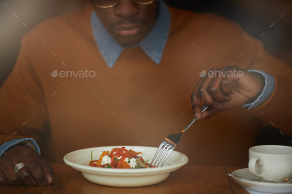 African-American Man Eating Salad - Stock Photo - Images