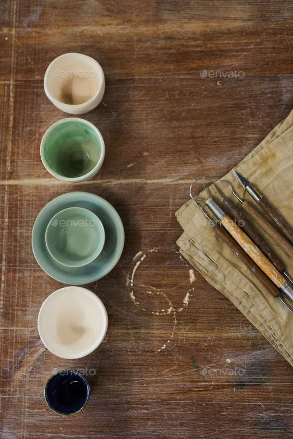 Clay modelling tools and ceramic bowls - Stock Photo - Images