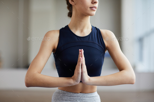 Woman joining hands in Namaste gesture - Stock Photo - Images