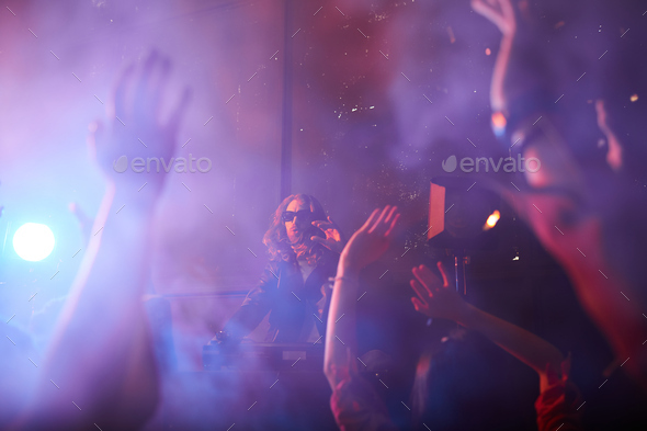 Popular dj playing at party - Stock Photo - Images