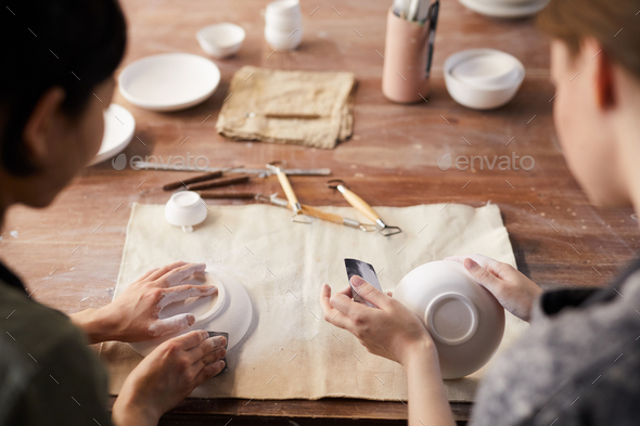 Polishing clay dishes with sandpapers - Stock Photo - Images