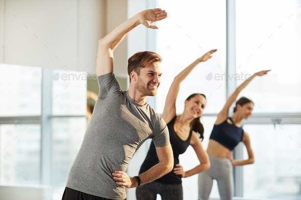 General yoga class for men and women - Stock Photo - Images