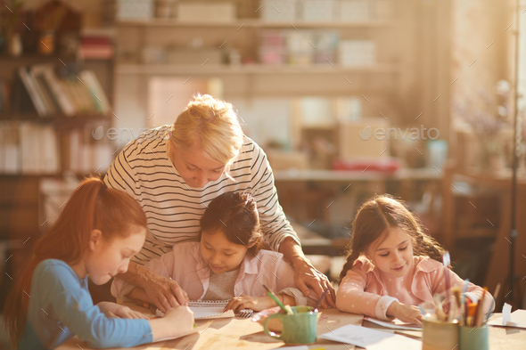 Kids Painting in Sunlight - Stock Photo - Images