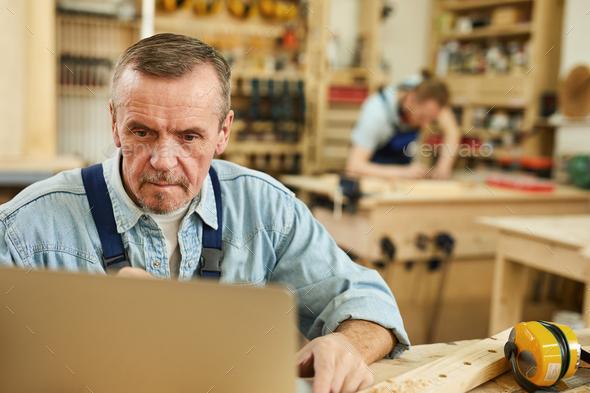 Senior Worker Using Laptop - Stock Photo - Images