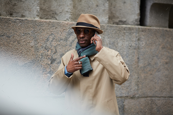 Modern African Man Speaking by Phone in City - Stock Photo - Images