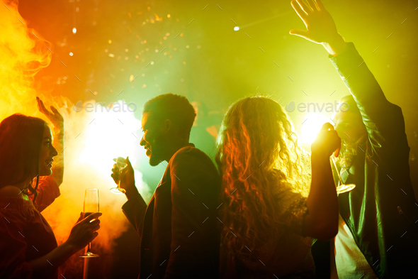 Happy young people enjoying party time - Stock Photo - Images