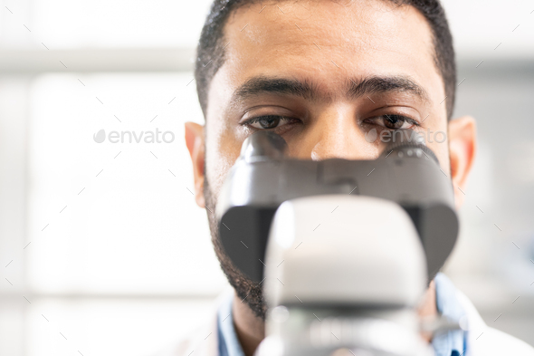 Lab biologist studying cells - Stock Photo - Images
