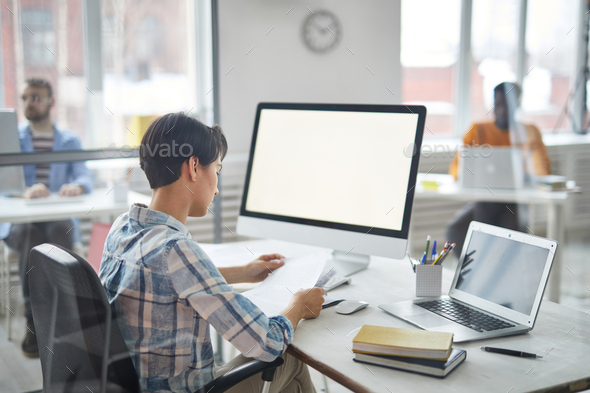 Manager reading papers - Stock Photo - Images