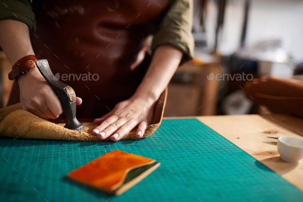 Woman Making Leather Wallet - Stock Photo - Images