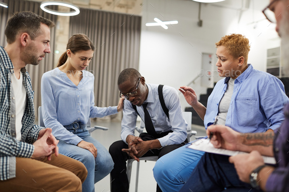 African Man in Support Group - Stock Photo - Images