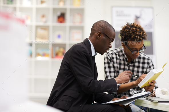 Business school students analyzing notes - Stock Photo - Images