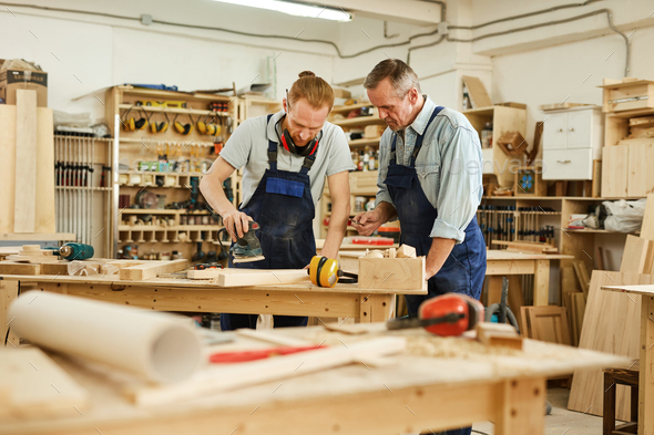 Father and Son Working - Stock Photo - Images
