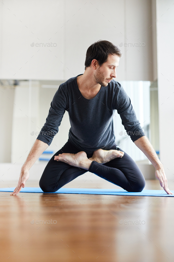 Young yogis standing on knees in lotus position - Stock Photo - Images