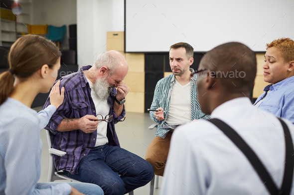 Senior Man Crying in Support Group - Stock Photo - Images
