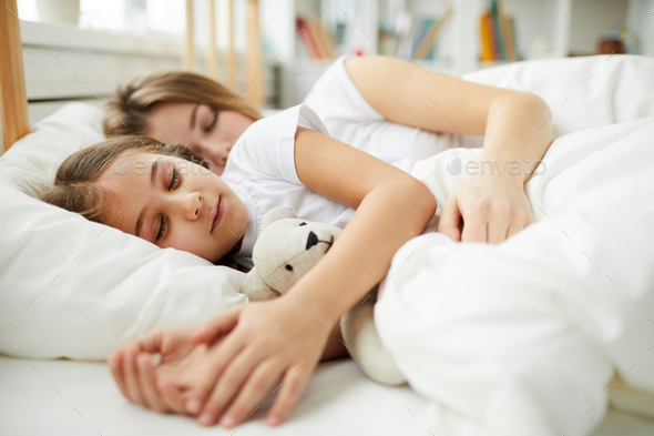 Mother and Daughter Sleeping Together - Stock Photo - Images