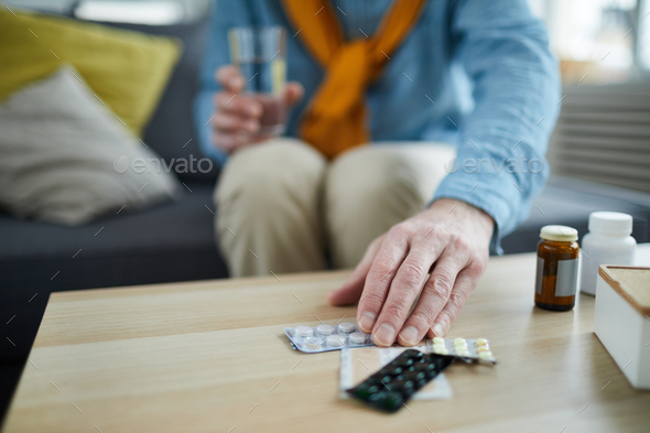 Unrecognizable Man Taking Pills - Stock Photo - Images