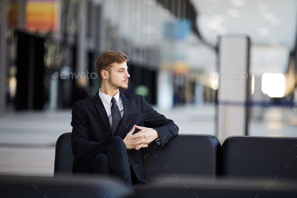 Pensive Businessman in Airport - Stock Photo - Images