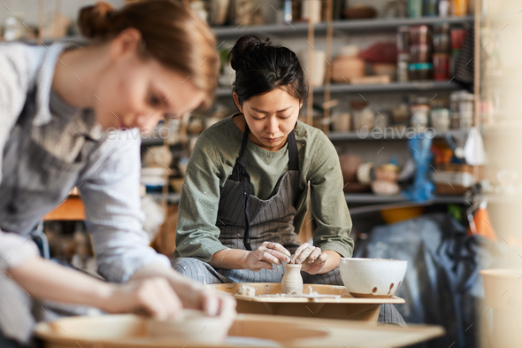 Skilled potter making clay vase - Stock Photo - Images