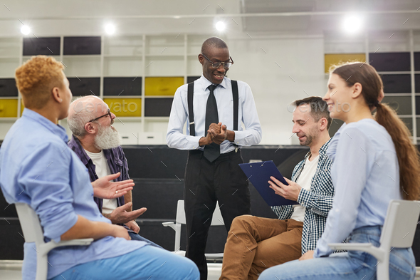 African Man Sharing Success Story - Stock Photo - Images