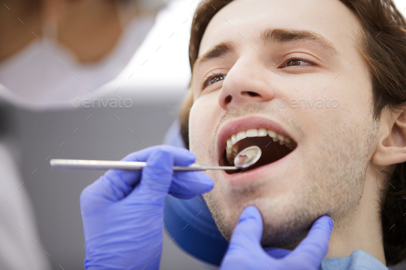 Man in Dental Chair - Stock Photo - Images