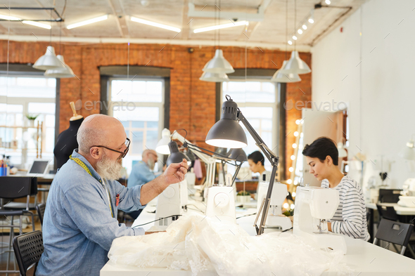 Tailor sewing in workshop - Stock Photo - Images