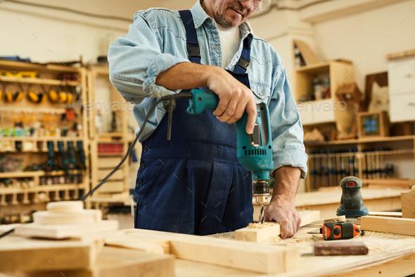 Unrecognizable Carpenter Drilling Wood - Stock Photo - Images