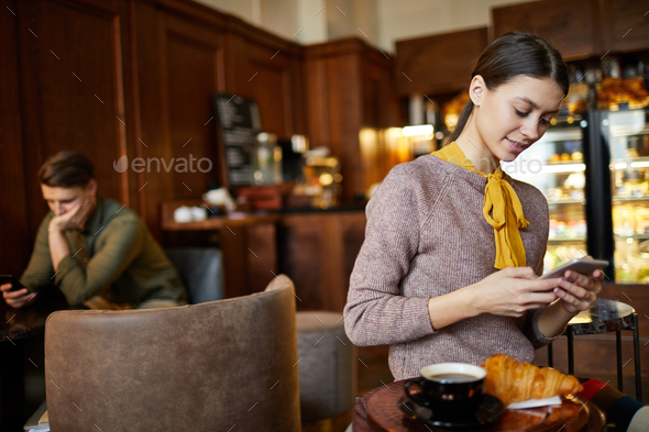 Girl using smartphone - Stock Photo - Images