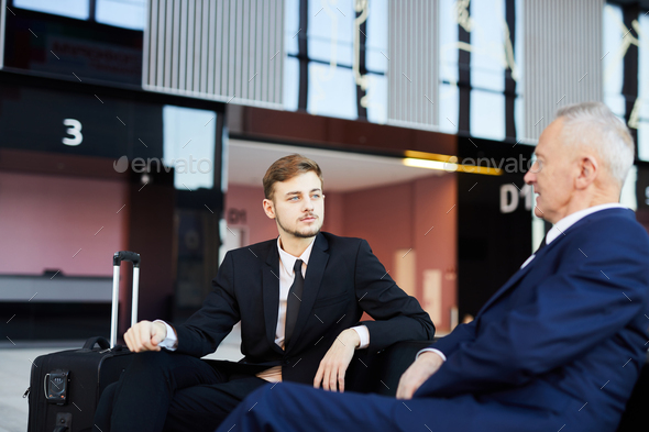 Two Business People in Airport - Stock Photo - Images