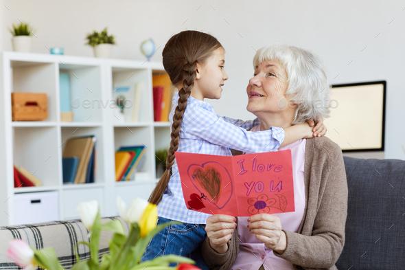 Senior Woman Embracing Cute Girl - Stock Photo - Images