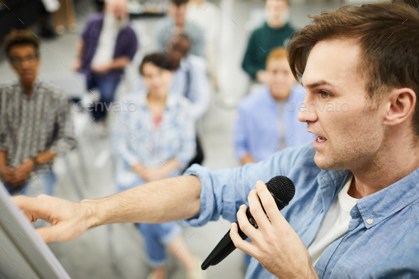 Confident man telling about powerful sales tools - Stock Photo - Images