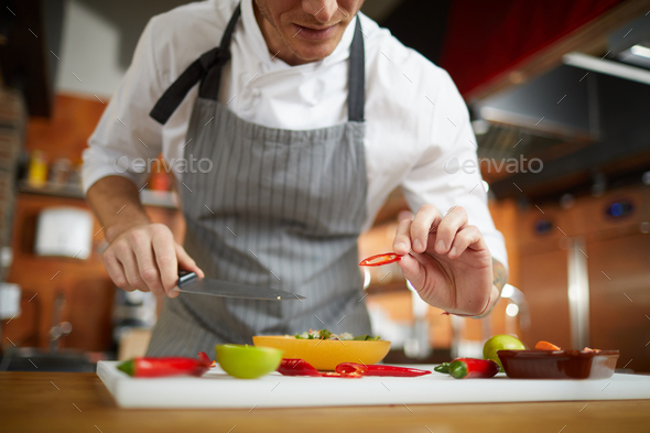 Unrecognizable Chef Cutting Vegetables - Stock Photo - Images
