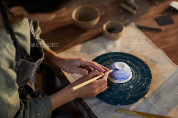 Potter painting ceramic bowl - Stock Photo - Images