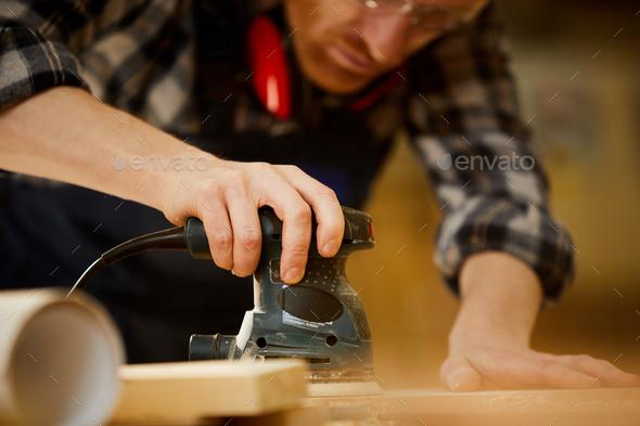 Carpenter Polishing Wood Closeup - Stock Photo - Images