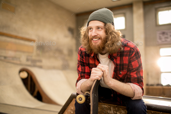 Bearded Young Man in Skate Park - Stock Photo - Images